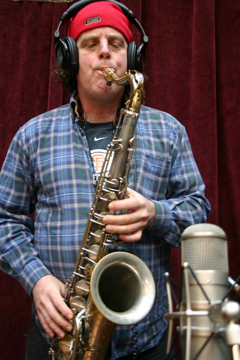 Doug Rowan, of the Wide Hive Players, playing a saxophone.