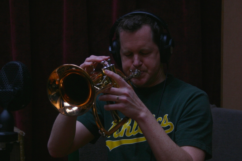 A picture of Erik Jekabson playing a trumpet.
