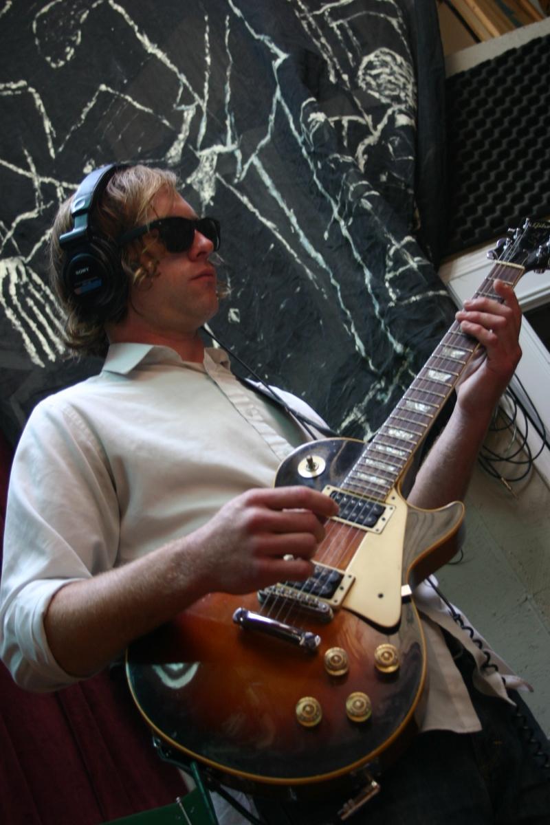 Matt Montgomery playing guitar.