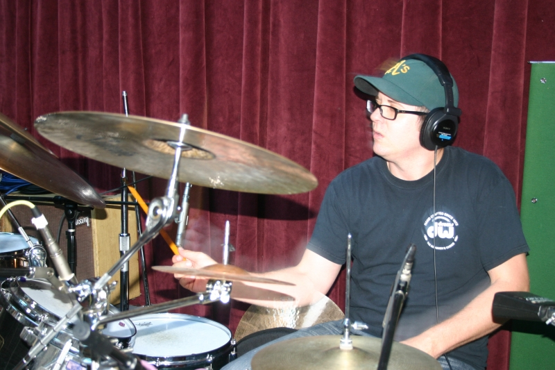 """A photo of Mike Hughes during the recording of """"Jagged Rocks"""" (Throttle Elevator Music)"""