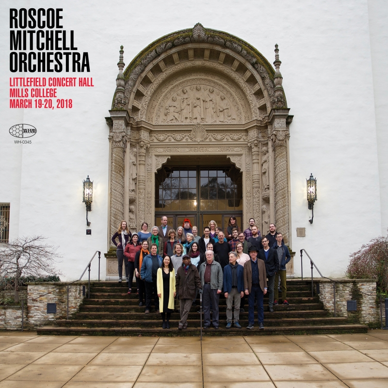 A photo of Roscoe Mitchell Orchestra standing on the steps of Littlefield Concert Hall at Mills College in Oakland, California.