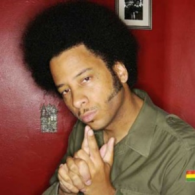 A photo of Boots Riley looking thoughtful.