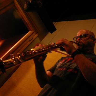 A picture of Dave Ellis playing the tenor saxophone.