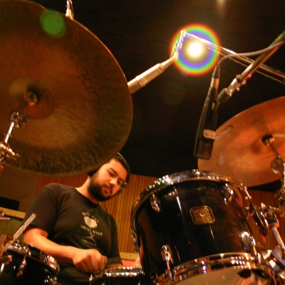 A picture of Hamir Atwall playing the drums.