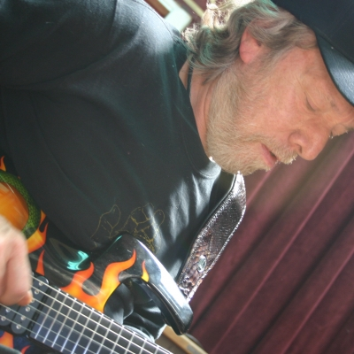 A picture of Harvey Mandel Playing the guitar.