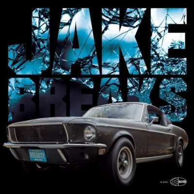"""A photo of a classic Ford Mustang with the words """"Jake Breaks"""" behind it."""