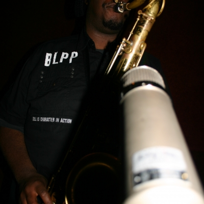 "Kamasi Washington, playing a saxophone on the Throttle Elevator Music album ""Area J."""