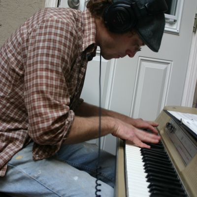 A photo of Matt Montgomery at the Piano.