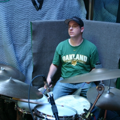 "Mike ""Lumpy"" Hughes at Wide Hive Studios, playing drums on the Larry Coryell release, ""Heavy Feel."""