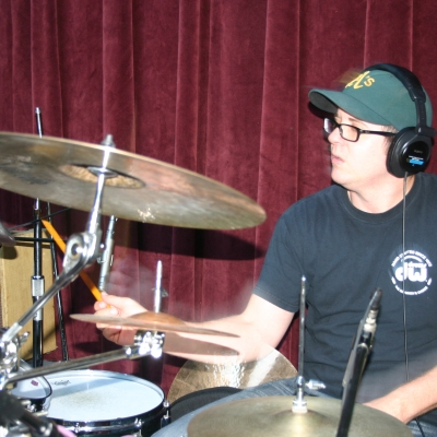 "Mike ""Lumpy"" Hughes, playing drums on the Throttle Elevator Music release, ""Jagged Rocks."""