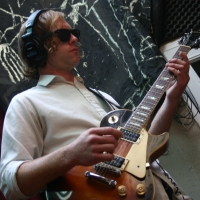 Matt Montgomery playing guitar.